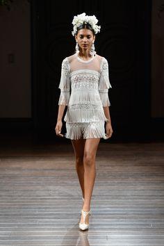 A mini-flapper dress: http://www.stylemepretty.com/2015/10/10/naeem-khan-fall-2016/