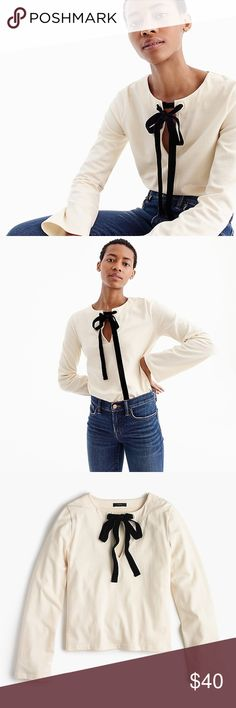 J. Crew Velvet Tie-Front Top in Vintage Champagne J. Crew Velvet Tie-Front Top in Vintage Champagne Ivory with black velvet bow New with tags  PRODUCT DETAILS Comfy cotton + a cute velvet tie = the work-to-weekend-to-holiday-party top you'll be wearing with everything all winter long.  Cotton. Machine wash. Import. Item H3675. J. Crew Tops Blouses
