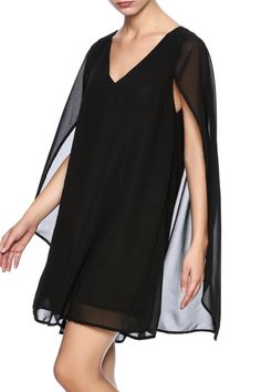 Black shift dress with cape like sleeves, v-neckline and full lining.    Cape Dress by KORI AMERICA. Clothing - Dresses - LBD Laredo, Texas