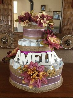 Burlap and flowers diaper cake. Rustic baby shower. Love!!! But blue instead!