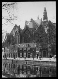 1960's. The 800-year-old Oude Kerk (old church) is Amsterdam's oldest building and oldest parish church, located at the Oudekerksplein 23. The church was founded around 1213 and consecrated in 1306 by the bishop of Utrecht with Saint Nicolas as its patron saint. After the Reformation in 1578 it became a Calvinist church, which it remains today. The church is located in Amsterdam's red-light district. The square surrounding the church is called the Oudekerksplein. #amsterdam #1960 #Oudekerk
