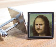 Cufflinks decorated with the love child of Ron Swanson and Mona Lisa. | 24 Gifts Only People Who Like Art Will Appreciate