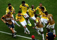 James Rodriguez of Colombia celebrates by dancing with teammates after scoring his team's first goal during the 2014 FIFA World Cup Brazil Group C match between Colombia and Cote D'Ivoire at Estadio Nacional on June 2014 in Brasilia, Brazil. James Rodriguez Colombia, World Cup 2014, Fifa World Cup, Lionel Messi, Soccer Players, Football Soccer, Football Jokes, Football Celebrations, World Cup Groups