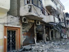A picture shows damaged buildings in Bayyada neighbourhood in the central province of Homs.