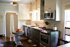 obsessed with this kitchen makeover. I need those fixtures in my life