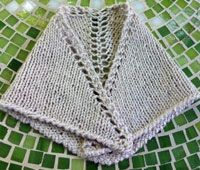 This beautiful lacy knitted shawl pattern has even more embellishments built in, but is still a simple prayer shawl pattern.