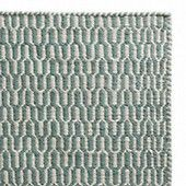 Vibrant teal join natural beige to form a diamond weave showcased in our regal Dasheri Rug. Ethically hand-loomed in India according to Fairtrade standards, this stunning piece is made according to age-old techniques using all-natural jute. Contrasting threads are worked together to create the repeated diamond pattern, while beige threads are knotted and cut to form a fringe finish along the width.   Team with our rug underlay to ensure your rug stands the test of time.