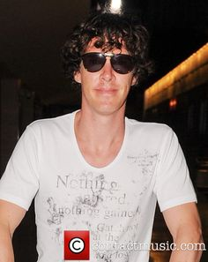 Benedict Cumberbatch Arrives In Ibiza - So tan and he was just getting there lol.
