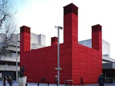 The Shed: Temporary Red Theater Cooled Naturally with Four Corner Chimneys in London