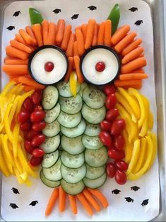 "DIY Owl Vegetable Tray. Use sliced cucumbers for the inner body, pear tomatoes for the outer body, yellow peppets for wings, baby carrots for the feet and the head. Use small black ramekins or souffle cups for the eyes. Place ranch dressing inside and 1 pear tomato in the center. Found on Facebook at ""Kitchen Fun With My 3 Sons""."