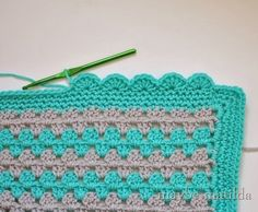 scalloped border: she explains really clearly how to crochet a scalloped border