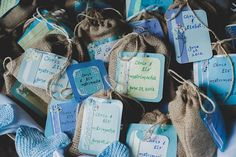 'matrimocha' (bags of coffee) wedding favours wrapped in burlap and displayed in a wheel barrow