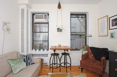 Name: Sam Location: West Village; New York City Size: 300 square feet Years lived in: 1 Year; Rented Keeping her home clear of clutter and displaying only the things she loves gives Sam's 300-square-foot home in the West Village a spacious feel. Meanwhile, light from the many windows, pops of color, and the warm, neutral tones of her decor go a long way towards making it feel welcoming, comfortable, and soothing.