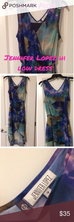 ❤️Jennifer Lopez hi low watercolor dress ❤️SALE PRICE LOWEST PRICE LISTED❤️ ⚓️Host Pick 4/15/17 simply chic⚓️ Gorgeous hi low dress by Jennifer Lopez..EUC..has a dark blue slip that is about 36 in length, the back skirt is about 50 in length while the front is about 43 in..about 17 in flat at bust..comes with a tie belt that is removable and elastic waist. 7/1/17 Jennifer Lopez Dresses High Low