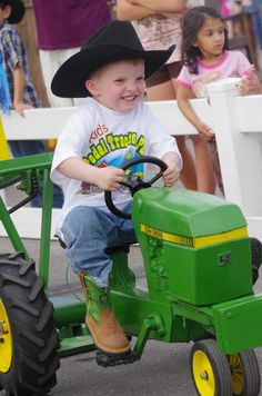 This little guy is having a great time on his #JohnDeere tractor during his visit to #RODEOHOUSTON!