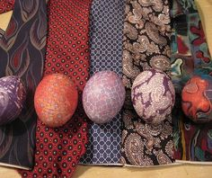 Wrap a raw egg in silk from an old tie and boil it to get patterned eggs.