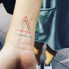 What does a double triangle tattoo mean? - Quora