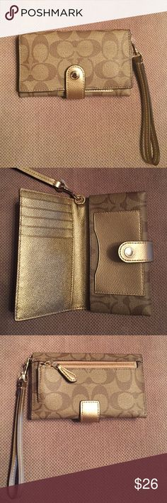 COACH wristlet/ phone case. Fits iPhone 5 & 6 Great condition, only used once. Can be use as wallet and holds 6 cards, cash, coins and a phone! Coach Bags Clutches & Wristlets