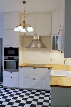 Black & white checkered floor bare bones kitchen
