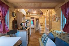 This tiny home has two loft beds and a third single bed beneath the main loft. Really love the economy of it.