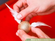 How to Make a Golden Snitch. Ever wanted to make a Golden Snitch? It might not fly on its own, but crafting your own decorative Golden Snitch can be a fun way to celebrate and show off your love of Harry Potter and the beloved game of. Objet Harry Potter, Gateau Harry Potter, Harry Potter Snitch, Harry Potter Nursery, Harry Potter Classroom, Theme Harry Potter, Harry Potter Baby Shower, Harry Potter Wedding, Harry Potter Birthday