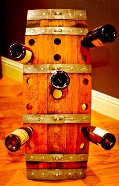 This unique wine barrel riddling rack will allow you to display 18 bottles of wine in style.