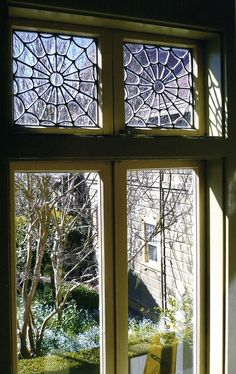 Witch Cottage ~ spider-web leaded-glass windows.