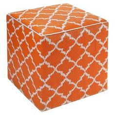 "Offer extra seating in the living room or rest a tray of hors d'oeuvres on the patio with this eye-catching indoor/outdoor pouf, showcasing a quatrefoil trellis motif for cosmopolitan appeal.    Product: PoufConstruction Material: Recycled polypropylene cover and polystyrene fillColor: CarrotFeatures:  Handmade by skilled artisansSuitable for indoor and outdoor useWeather and mildew resistant Can be used as seating or as a tableDimensions: 18"" H x 18"" W x 18"" DCleaning and Care: Spot clean…"