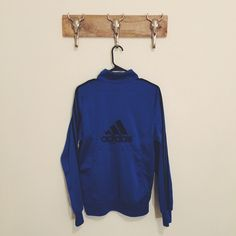 Adidas Jacket Great condition Just a small mark on the front as pictured Fits like a M/L not sure of the size since the tag is gone Feel free to ask me any questions Thanks for browsing my closet! Happy Poshing Adidas Jackets & Coats