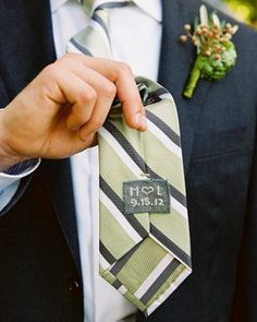 "Cross-stitch a surprise on your groom's tie for the big day. ""M ♥ L ~ 9-15-13""  Compliments of Martha Stewart Weddings."