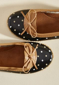 The weather won't stop you from feeling winsome while you run errands in these polka-dotted rain shoes! Wonderfully waterproof, these black slip-ons star camel and white speckles, leather trim, and treaded soles that assure some spirited steps past the puddles!