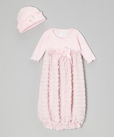 Boasting a big floral appliqué and snuggly-soft construction, this cozy pair is all set to soothe. A stretchy elastic hem ensures that wiggly little legs stay covered in the sweetest style, while a matching beanie keeps Baby's precious head nice and toasty.Includes gown and beanieBeanie: 13.5'' circumferenceCotton / pol...
