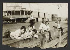 Boys on Wharf by Jessie Tarbox Beals.