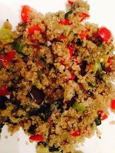 Quinoa roasted with garlic and cooked wit sautéed veggies. dice eggplant, sprinkle lil garlic salt and fresh ground black pepper and bake for 20min at 350 F..meanwhile, rinse quinoa and roast it a lil wit some garlic for flavory grains.. den cook it in a open pan til fluffy.. on another stove, saute some garlic,red peppers, spinach and green onions..add salt.. put the baked eggplant onto this medley..finally add the cooked quinoa..u could top it with some cheese too