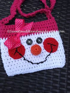 THIS ADORABLE PURSE HAS BEEN RECENTLY COMPLETED AND IS READY TO SHIP!!!  WILL SHIP IN 1 TO 2 DAYS!  This listing is for a the most adorable little girls snowman purse. She is made of 100% cotton yarn with a crochet nose, button eyes and an embroidered smile. Ive given her a hot pink