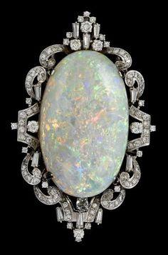14 karat white gold diamond and cabochon opal brooch.