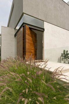 stucco and pivot door