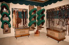 Inside of a tack room with matching tack trunks, saddle covers and bridle racks from http://www.tacktrunks.net