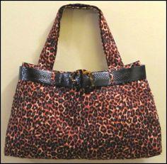 Brown Jean Leopard handbag, black belt. https://poshmark.com/closet/haveheartdailys?availability=all&spt=true