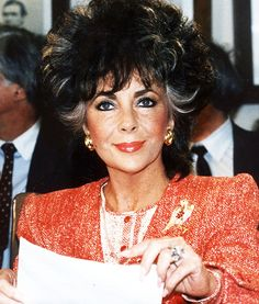 """In 1986, Elizabeth Taylor testified before a Senate subcommittee in Washington DC to raise badly needed funds for HIV/AIDS research.  """"Since my friend Rock Hudson died of AIDS last year I have worked with the American Foundation for AIDS Research….I have become familiar with the tragedy of AIDS and I am acutely aware of research funding needs. A comprehensive, sustained basic research effort will pay off in many ways."""" That same year, she helped found amFAR, which has raised nearly $325…"""