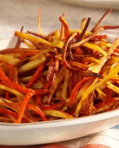 A salty-sweet dish of oven-roasted carrots and parsnips is a quick, healthy alternative to traditional french fries.Get the Carrot and Parsnip Fries Recipe Vegetable Sides, Vegetable Recipes, Vegetarian Recipes, Cooking Recipes, Healthy Recipes, Carrot Fries, Roasted Carrots And Parsnips, Parsnip Recipes, Appetizers