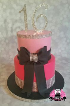 A very elegant and glittery cake for a girl celebrating her sixteenth birthday. The rhinestones are real, & not edible. The client supplied the beautiful topper. Both tiers were marble cake with chocolate silk buttercream filling, dark...