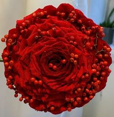 red rose glamelia bouquet with holly