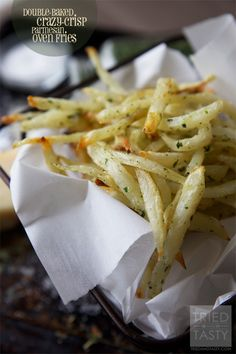 Double Baked, Crazy Crisp Parmesan Oven Fries via Tried and Tasty