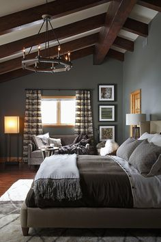 Beautifully styled grey bedroom looking elegantly masculine and very smart indeed.
