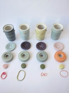 """BEN FIESSporcelain jars  61/2"""" H   Porcelain bodies, glazed interiors (can hold solids and liquids) and colorful outsides with rubber band closure system."""