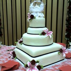 Wilton wedding cake. Made at Bings in Sedalia, MO. Each layer is a different flavor.
