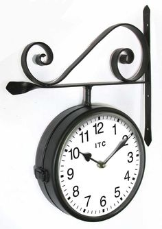 The Double sided black Wall Clock by Infinity Instruments offers a decorative, oversized, double sided wall clock. This is a cool novelty clock with black metal frame and bracket, white dial and Arabic numbers, it will have everyone talking.  $37.95
