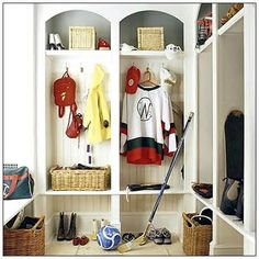 Hysterical: This is clearly staged by a non-hockey mom - Most hockey moms would not tolerate stinky hockey gear in her mud room, especially for a player in that size jersey, maybe a 4 year old's gear.