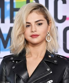 Kill 'em with blondeness: Selena Gomez, 25, debuted a platinum look with dark roots that her hairstylist is calling 'Nirvana blonde'